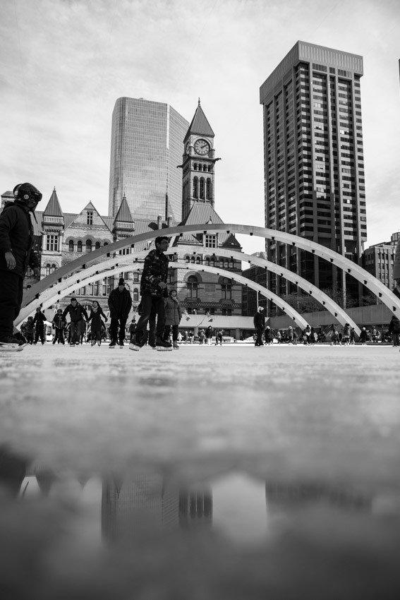 Toronto black and white Nathan Phillips Square Skating