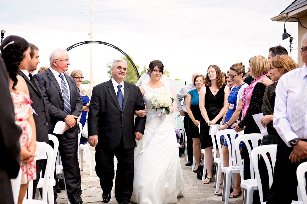 bride walks down the aisle wedding party wedding ceremony Otellos Centre Oakville Wedding toronto wedding photographer